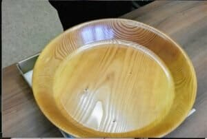 The bowl was turned from wood of a downed tree in the inaugural plantation