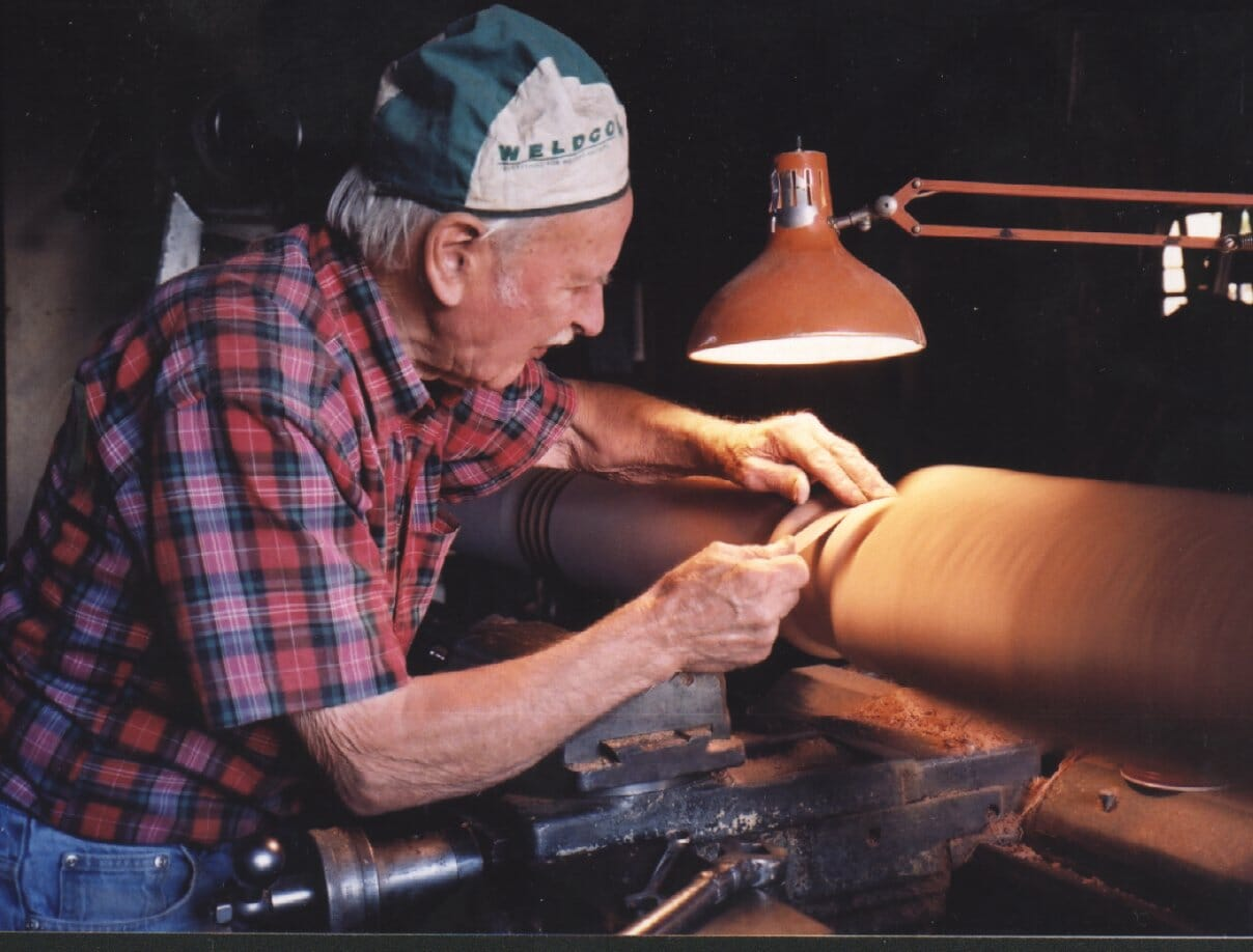 John Tompson turning a post on his home-made lathe. John was a tree planter at the nursery and involved with the preservation of the forest in the 1980s
